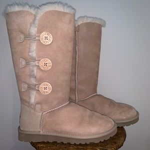 tan tall Ugg boots with buttons